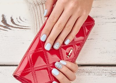 Red leather wallet in female hands.