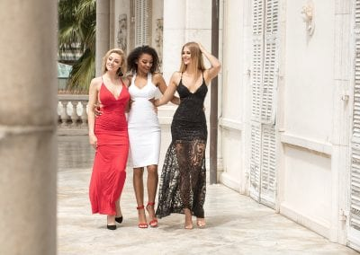 Group of beautiful sexy ladies in elegant dresses at sunny summer day.