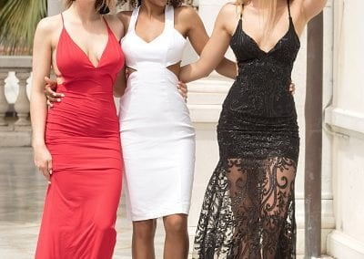 Group of beautiful sexy ladies in elegant dresses at sunny summe